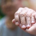 Image: Seniors holding hands.